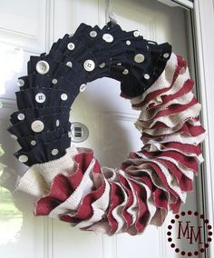 Patriotic burlap wreath - I like the idea of hot gluing buttons on there too.  Could also do that with spring or fall color palette.