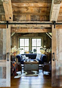 A Rustic Living Room - Love the sliding barn doors