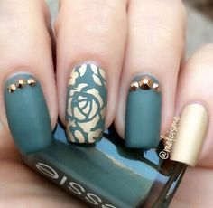 Beautiful dark green rose nail art design. The rose is painted in beautiful gold colors with gold embellishments to accompany it. He contrast between the dark green and gold look simply wonderful.