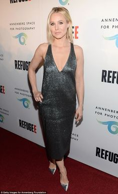 Standout: Kristen Bell looked stylish in a low-cut metallic dress at the opening of the Refugee exhibit at the Annenberg Space For Photography in Los Angeles on Thursday