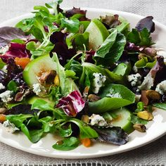 Sweet-tart apples, pungent blue cheese and crunchy pistachios make an irresistible combination in this fall salad.