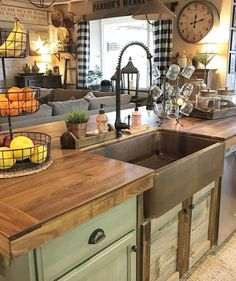 I love this copper apron sink, especially with the green cabinets and darker faucet. Plus, the doors under the sink bring in some of the rustic barn wood, without having to do all the cabinets with barn wood.