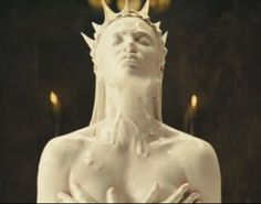 Charlize Theron as the evil Queen and stepmother at http://www.moviesandtvhistoryguy.com/snow_white_and_the_huntsman.htm