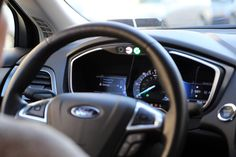 Uber's self-driving vehicles activate internal controls like blinkers using sensing data similar to GPS. The cars first began ferrying passengers in Pittsburgh on Wednesday, Sept. 13, 2016.