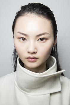 porcelain skin, long slick black hair, cool brown eyes, asian