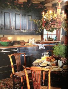 Rustic kitchen, Black cupboards... would love my kitchen to look like this!