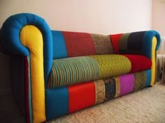 large patchwork couch, supper comfy and great for any room to give that pop of color. on sale!
