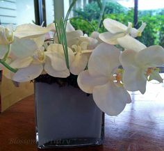 White phaleonopsis orchids in an arrangement for the Sponsors' Tents at the 2014 U. S. Open in Pinehurst, NC.