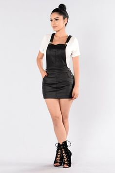- Available in Black - Overalls - 5 Pocket Design - Vegan Leather - Side Button Detail - 76% Rayon, 21% Nylon, 3% Spandex