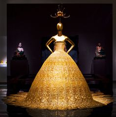 Gallery 208 - Guo Pei. In this dress by the Chinese designer Guo Pei, Buddhist iconography provides the primary source of inspiration. The bodice is shaped like a lotus flower, which is one of the eight Buddhist symbols and represents spiritual purity and enlightenment. #ChinaLookingGlass #AsianArt100