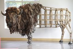 """American Bison/Prairie House""  76"" x 39"" x 130""    red oak, cast iron, hand-made uncarded felt.  Emily White 2011"