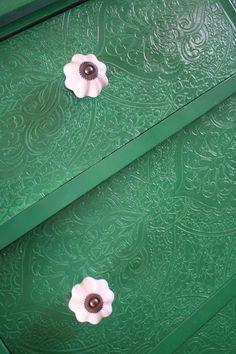 textured paintable wall paper on dresser drawer fronts