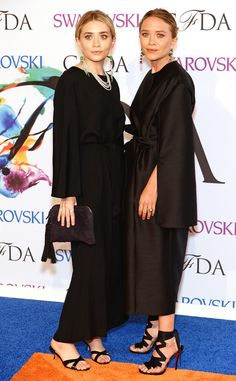 Mary-Kate and Ashley Olsen opt for similar-looking black ensembles.
