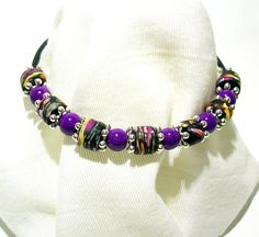 Simple Memory Wire Bracelet with Handmade Polymer Clay Bead and Purple Glass…