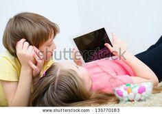 http://www.shutterstock.com/pic-135770183/stock-photo-children-watching-tablet-pc-computer.html?src=FHlC6Ti-yAtPmROzRyiSdA-1-49