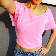 VS cropped tee-slouchy/boyfriend. Small. Bright pink crop slouchy tee. Size small, could fit up to a medium. It is very wide. A bit to wide for me. Victoria's Secret Tops