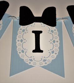 Pretty Alice in Wonderland-themed banner in the traditional colors of light blue, white, and black. This banner can be personalized however you wish. Perfect as a name banner for your childs nursery or room decor, ideal for any Wonderland/Tea Party-themed baby shower, bridal shower, or birthday party. Like what you see? Favorite my shop and you will receive a 15% off discount on your first order. PLEASE FULLY READ THE DESCRIPTION BEFORE ORDERING. THANK YOU! **Details: The light blue…