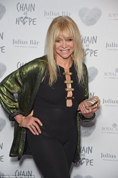 Looking svelte: Jo had plumped for a fitted one piece ensemble with a metallic jacket. Metallic Jacket, Pink Gowns, Fine Jewelry, Jewellery, Charity, Pixie, Fashion Inspiration, Backless, One Piece