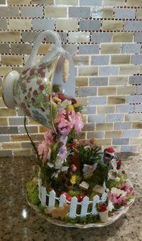 Floating teacup fairy garden