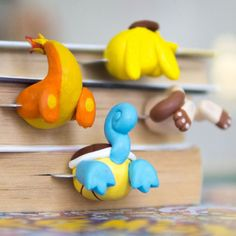 Keep track of reading progress through your favorite book with these hilarious Pokemon butt bookmarks! Each bookmark is handmade with polymer clay and looks as though they're burrowing into the page where you last left off.