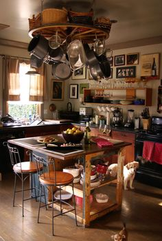 Wagon Wheel Pot Rack + Open Shelving + Framed pictures in Kitchen.. x Island and Puppies squared...Whef!