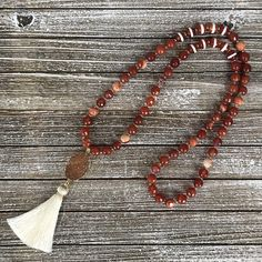 Austin Tassel Necklace Perfect compliment to the Austin Bracelet Stack! Inspired by my Dad's alma mater the University of Texas. Burnt orange and white should be the city's signature colors! Faceted Fire Agate and striped Agate compliment the gorgeous Druzy Quartz pendent. 32 inch