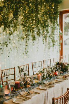 wedding reception with hanging greenery - photo by Paula O'Hara http://ruffledblog.com/art-nouveau-irish-mansion-wedding