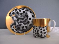 ROSENTHAL. FORNASETTI DEMITASSE CUP & SAUCER. SPOTTED CATS.