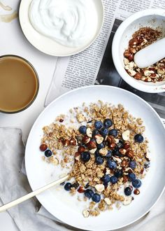 Idea for a make ahead Muesli. hazelnut blueberry granola served with fresh blueberries, milk & yoghurt.