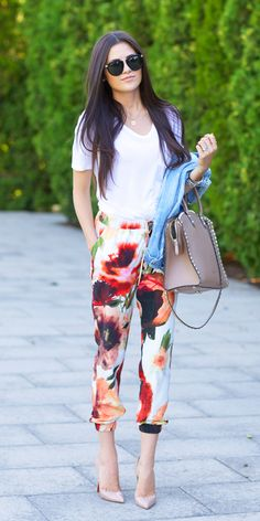 Rachel Parcell is wearing floral silk pants from Nordstrom, white T-shirt from Alexander Wang, bag from Valentino, shoes from Christian Louboutin and sunglasses from Karen Walker