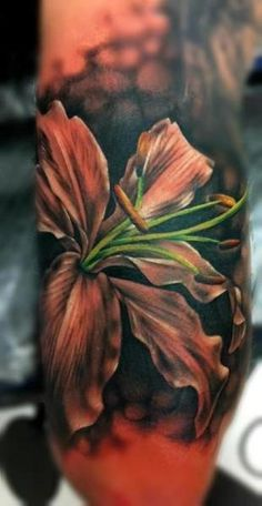Photo Realistic Flower Tattoo... I love a pop of color on a black background