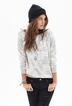 Perfect for chilly days and balmy nights, this heathered sweatshirt features a rose print and long raglan sleeves.  http://foxyblu.com/details/141624