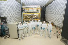 A team of engineers in special clean room suits at NASA Goddard.