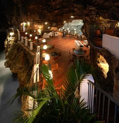 The mist sweeps in from the sea and the waves crash onto the rocks beneath your table. No experience on earth can beat a meal at the cave restaurant in Polignano - Puglia, Italy