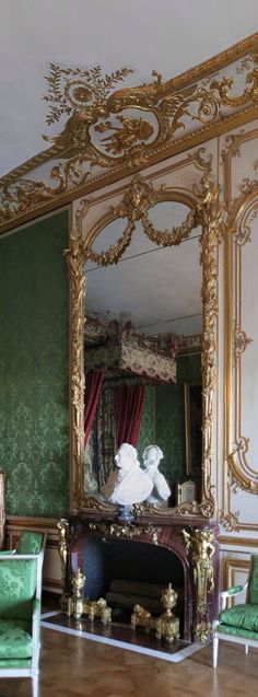 Château de Versailles, appartements du Dauphin et de la Dauphine, chambre du Dauphin (1747). Cheminée (en marbre griotte rouge de Campan, décors en bronze doré). These ground floor apartments were created for the premier members of the Royal family, firstly for Louis, Dauphin of France (eldest son of Louis XV) and his wife and later occupied by the children of the ill-fated Louis XVI.