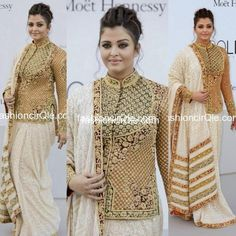Love this outfit on Aishwarya by Abu Sandeep Khosla ! The saree look makes it even more appealing !