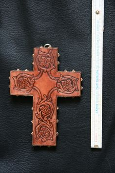 Carved leather cross