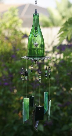 One of A Kind Wind Chime - Calypso is made from Stained Glass, Green Bottle, Up-cycled Metal Piece & Beads. Unique Indoor/Outdoor Chime