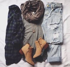 Plaid, boots, and jeans.