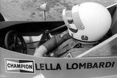 Lella Lombardi in her car at the British Grand Prix