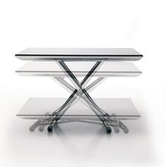 The Magic, a transforming coffee table, turns into a dining table. With an aluminum base and smooth lifting mechanism, the Magic adjusts to any height.