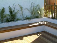 The rendered walls were painted gardenia white and the deck lights were positioned into the decking. Steps were constructed to get to the garden area which was now totally transformed and ready to use.