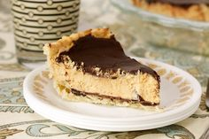 Crisp chocolate, fluffy peanut butter, and rich ganache fill a flaky crust in this Peanut Butter Cup Pie. It's a vegan dessert that is not to be missed.