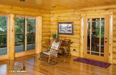 Log Home By Golden Eagle Log Homes - Dining Area - View of lake