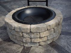 s 15 ways concrete pavers can totally transform your backyard, concrete masonry, curb appeal, outdoor living, Stack pavers into a fun fire pit