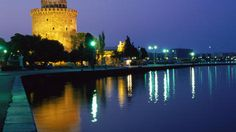 White Tower, century symbol of Thessaloniki, reflected on water at night. Night Train, Slow Travel, Greece Islands, Thessaloniki, Island Beach, Greece Travel, Lonely Planet, Athens, Beautiful Places