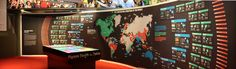 interactive showcase with wall that display the different parts of the world map.    The World of Cricket by Maria Pia Mosquera, via Behance