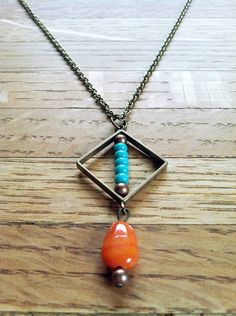 The Poppy  Geometric Turquoise & Tangerine by bruStreetBazaar, $20.00