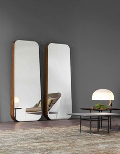 Obel Bonaldo Obel is a wall mirror which affords a generous reflective surface to make the individual play the starring role. (Roberto Paoli) Slightly tilted and shaped like a trapezium, the mirror rests on a slim wooden frame, which in turn rests against the wall, giving it volume and depth. http://www.martinelstore.com/en/prod/accessories/mirrors/obel-bonaldo.html