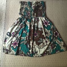 Floral Sundress Above the knee floral sundress. Back has two ties and 2 key hole cutouts (picture 2). Dresses Strapless